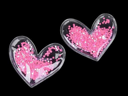 Aplikace srdce plněné sypanými flitry